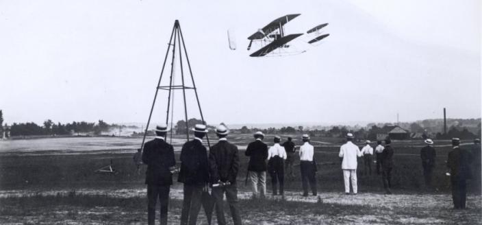 Wright Military Flyer flying at Ft Myer in 1909. Photo courtesy of the College Park Aviation Museum.