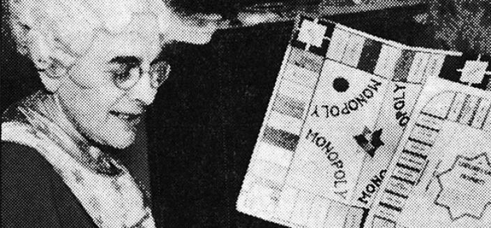 """Elizabeth Magie comparing a copy of """"Monopoly"""" to """"The Landlord's Game."""" (Image source: """"Designed to Teach,"""" Evening Star, January 28, 1936.)"""