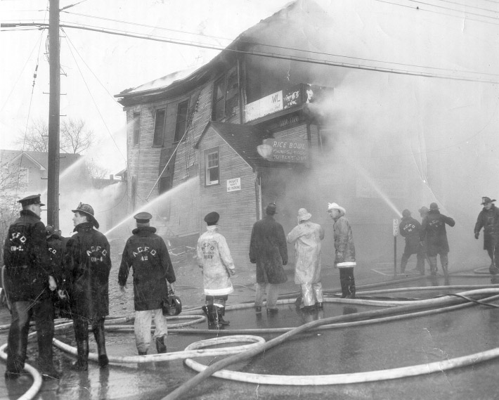 Arlington firefighters battle a blaze on Lee Highway in the 1950s. (Photo source: Chuck Kramaric)