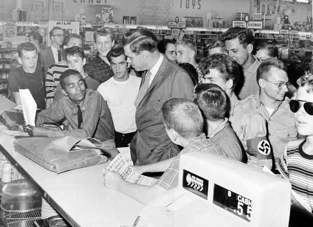 American Nazi Party leader George Lincoln Rockwell confronts demonstrator Dion Diamond at the Drug Fair in Cherrydale as others crowd the lunch counter. (Source: Washington Area Spark on Flickr.)