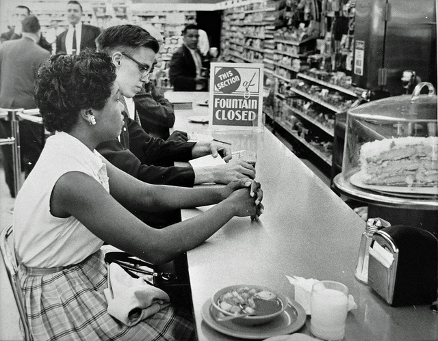 Gwendolyn Greene (later Britt) sits patiently at the People's Drug counter in Arlington, Virginia during a sit-in protest June 9, 1960. (Source: Washington Area Spark on Flickr)