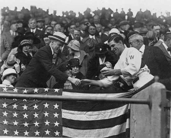 Washington Senators player-manager Bucky Harris presents a ball to Presisdent Calvin Coolidge at the 1924 World Series. (Photo source: Library of Congress.)