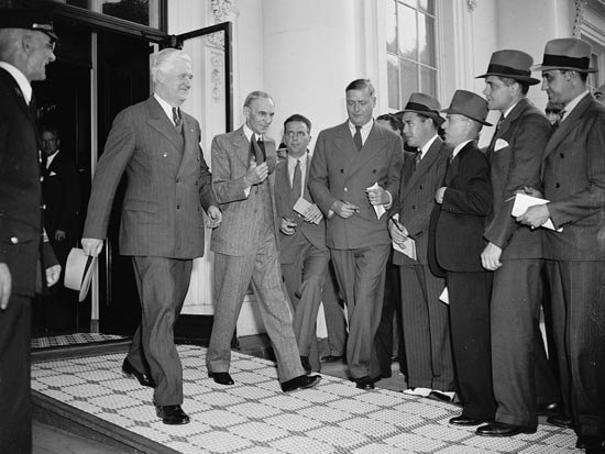 Henry Ford and his entourage leave the White House after their meeting with President Roosevelt, April 27, 1938. (Source: Library of Congress)