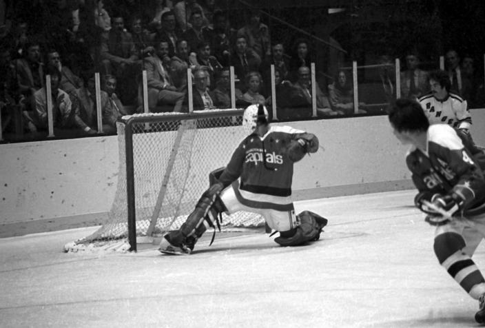 Goalie Ron Low #1 of the Washington Capitals makes the save during an NHL game against the New York Rangers on October 9, 1974 at the Madison Square Garden in New York, New York. (Photo by B Bennett/Getty Images)