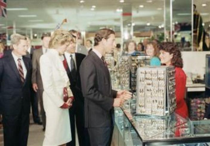Prince Charles stops to chat with a sales clerk at a costume jewelry display in the Springfield, Va., J.C. Penny store on Nov. 11, 1985. Princess Diana looks at the jewelry. (AP Photo)
