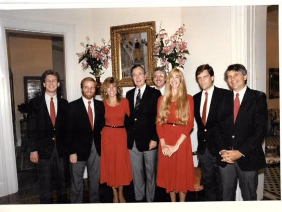 Seven members of the Capitol Steps with Vice President George H.W. Bush in 1988.