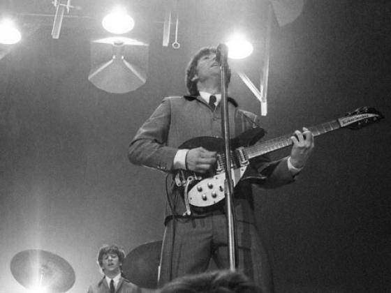 John Lennon and Ringo Starr underneath the lights at the Washington Coliseum, Feb. 11, 1964 (Photo credit: Mike Mitchell)