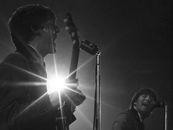 Paul and John shared lead vocals on several of the songs at the Washington Coliseum concert (Photo credit: Mike Mitchell)