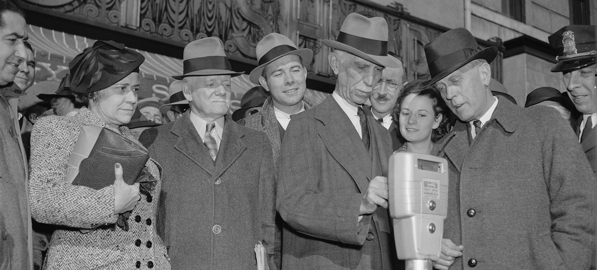 Commissioner Melvin Hazen and William Van Duzer put the first nickel in the parking meters ordered by Congress for a test in Washington, November 14, 1938. (Source: Library of Congress)