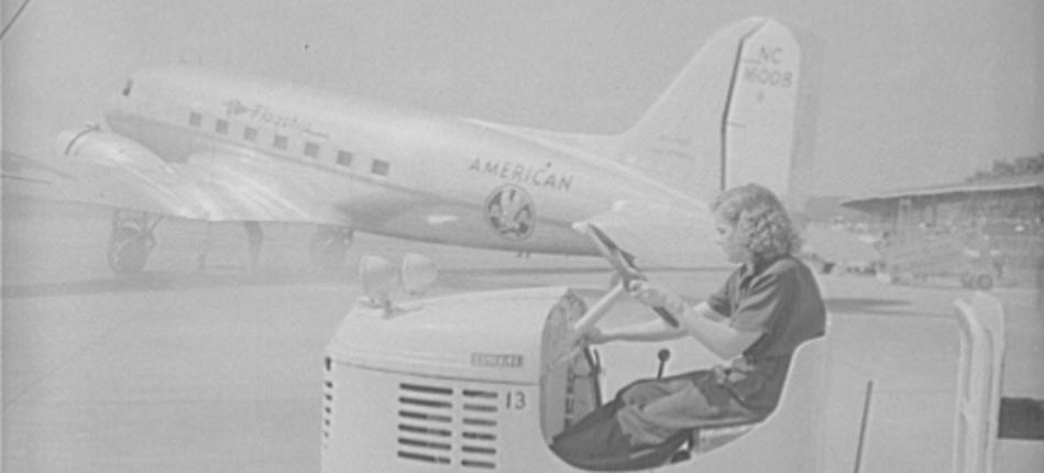 "At Washington National Airport in 1944, Mattie Marks scoots from plane to baggage room in her ""gas buggy,"" transporting passengers' suitcases and overnight bags. (Source: Library of Congress)"