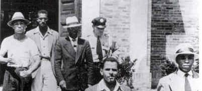 Five African American students are escorted from Alexandria Library, August 21, 1939. (Source: Wikipedia)
