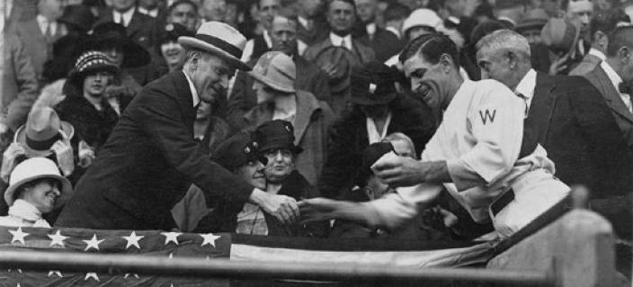 Washington Senators player-manager Bucky Harris presents a ball to Presisdent Calvin Coolidge at the 1924 World Series. Image Credit: Library of Congress