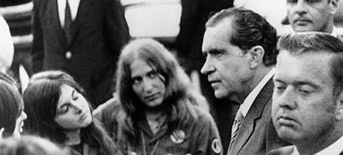 In the early morning hours of May 9, 1970 President Nixon drove to the Lincoln Memorial and mingled with a group of anti-war demonstrators. Here, Nixon chats with Barbara Hirsch, 24, of Cleveland, Ohio (left) and Lauree Moss, of Detroit, Mich. (Photo: © Bettmann/CORBIS)