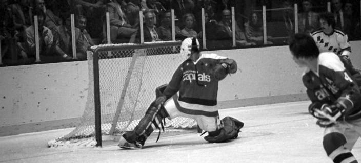 Goalie Ron Low of the Washington Capitals makes the save during an NHL game against the New York Rangers on October 9, 1974 at the Madison Square Garden in New York, New York. The newly-named franchise donned white shorts briefly in their first season. (Photo by B Bennett/Getty Images)
