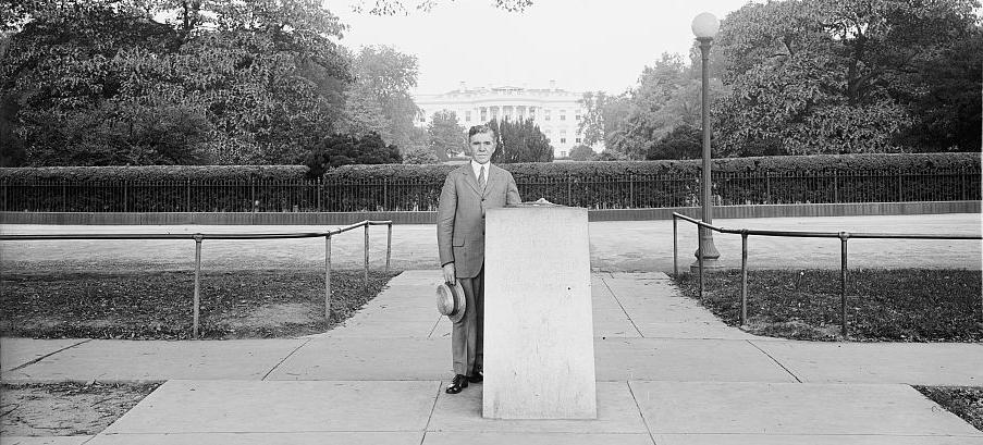Dr. S. M. Johnson stands next to the Zero Milestone marker. (Photo source: Library of Congress)