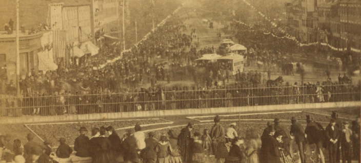 Crowds pack the top floor of the Treasury Building as the Carnival is in full swing on Pennsylvania Avenue. (Image source: Wikimedia Commons)