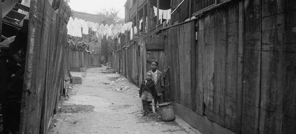 Two African American children in Washington, D.C. alley. (Photo source: Library of Congress)