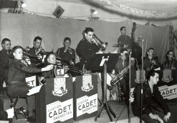 Captain Glenn Miller plays trombone in the Rhythmaires band at Maxwell Field, Dec. 24, 1942. The band played five times during Miller's five weeks at Maxwell, culminating with the Christmas Eve concert. (Photo Source: U.S. Air Force, Public Domain) http://www.maxwell.af.mil/News/Display/Article/704372/glenn-miller/