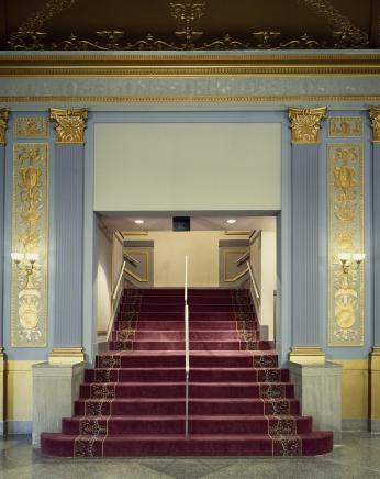 """Stairway at the restored Lincoln Theatre"" (Photo Source: The Library of Congress) Highsmith, Carol M, photographer. Stairway at the restored Lincoln Theatre, Washington, D.C. United States Washington D.C, None. [Between 1980 and 2006] Photograph. https://www.loc.gov/item/2011636444/."