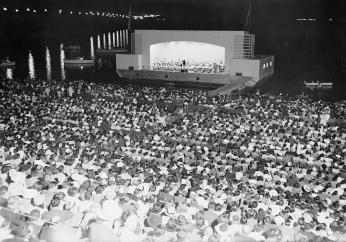 Hans Kindler conducts the NSO on the concert barge at the Watergate Amphitheatre in 1939.  (Photo Source: Library of Congress) https://www.loc.gov/pictures/item/hec2009013682/