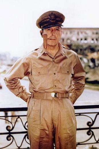 Douglas MacArthur, smoking his signature corncob pipe