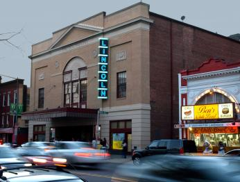 """Lincoln Theatre, exterior, evening,"" 2008 (Photo Source: Wikimedia Commons) https://commons.wikimedia.org/wiki/File:Lincoln_Theater_exterior,_evening.jpg"