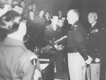 Army Air Forces Band personnel are congratulated by Gen. Eisenhower and Gen. Arnold at the National Press Club, Washington, DC, November 13, 1945 (Photo Source: dennismspragg.com) https://www.dennismspragg.com/inside-glenn-miller-declassified/homeward-bound/