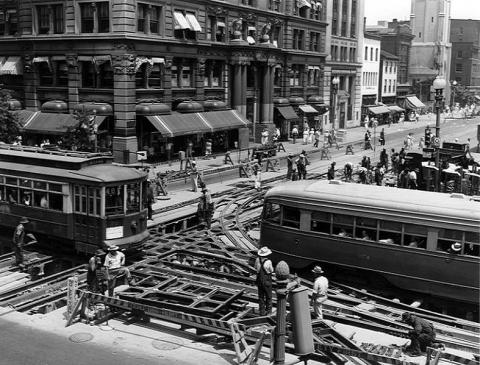Workers repair streetcar tracks at 14th and G Streets NW in 1941. Source: Library of Congress