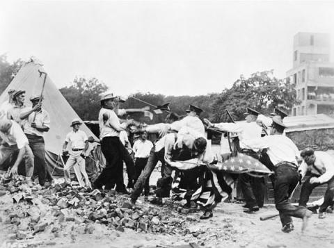 Bonus marchers tussle with local police at their campsite in 1932. Credit: National Archives