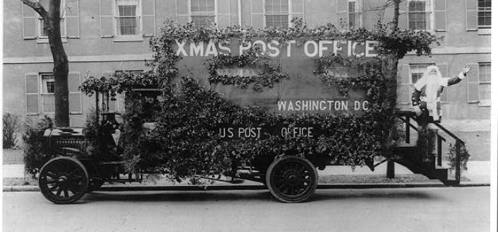 Postal truck in Washington decorated in an appeal for early mailing for the Christmas season, 1921. (Source: Library of Congress)