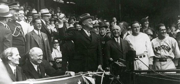 President Franklin D. Roosevelt, shown here in throwing out the ceremonial first pitch at Griffith Stadium in 1934, recommended that baseball continue during World War II. However, teams were expected to curtail travel and conduct spring training close to home. (Photo source: National Archives)