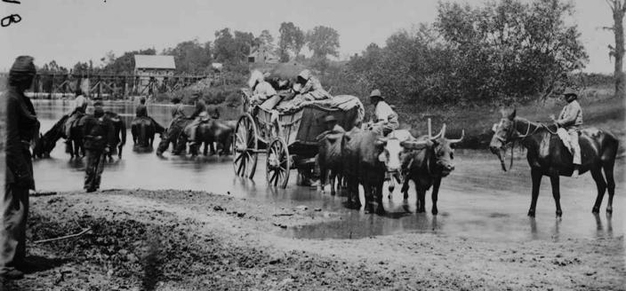 Fugitive African Americans fording the Rappahannock River, July-August 1862. (Source: Library of Congress)