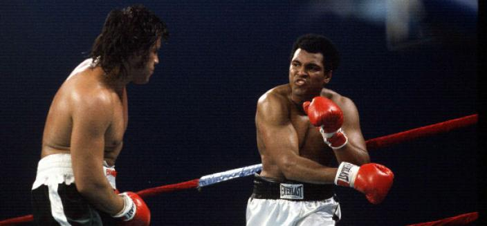 Mohammad Ali, right, throws a punch at Alfredo Evangelista, left, during an WBC/WBA heavyweight championship fight on May 16, 1977 at the Capital Center in Landover, Maryland. Ali won the fight with a unanimous decision. (Photo by Focus on Sport/Getty Images)