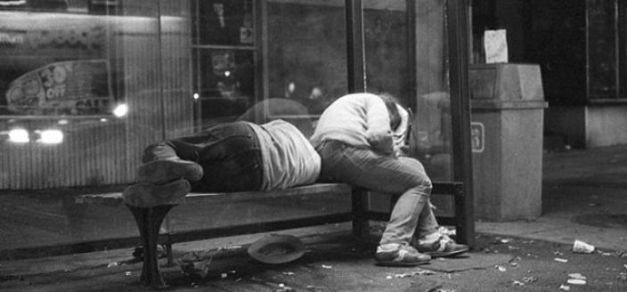 Homeless people sleeping at a bus stop, 14th and P St., NW, 1986. (Photo courtesy of Michael Horsley)