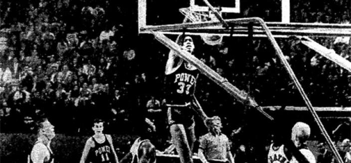 Lew Alcindor throws down a slam dunk in the 1965 game between Power Memorial Academy and DeMatha Catholic at Cole Field House. Dematha won the game and ended Power Memorial's 71 game winning streak. (Photo source: The Washington Star)