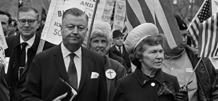 "With Bible in hand, the Rev. Carl McIntire and his wife, Fairy McIntire, lead the ""March for Victory"" on Pennsylvania Avenue in Washington, D.C., April 6, 1970. McIntire said his parade was a demonstration for military victory in Vietnam. (AP Photo/Bob Daugherty)"