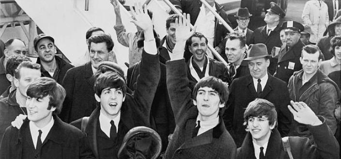 The Beatles were greeted by thousands of screaming teenagers when they arrived at Kennedy airport in New York on February 7, 1964. When they played their first American concert at the Washington Coliseum four days later, they were pelted with jellybeans while on stage. (Photo source: Wikipedia)