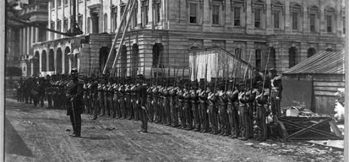 Union soldiers billeted at the Capitol practice drills in 1861. (Photo source: Library of Congress)