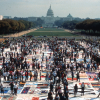 March participants view the AIDS Memorial Quilt on the National Mall on October 11, 1987. (Photograph courtesy of The NAMES Project.)