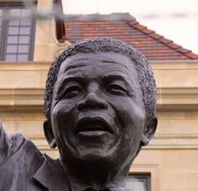 Statue of Nelson Mandela outside South African embassy in Washington, D.C. (Photo by flickr user taedc used via Creative Commons)