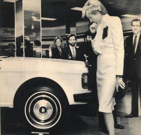 Princess Diana ponders a Rolls Royce sedan balancing on Wedgwood teacups on display at the J.C. Penney department store in Springfield, Va., Nov. 11, 1985. Their Royal Highnesses walked through the closed store in the Washington suburb. (AP Photo/Bob Daugherty) 1985