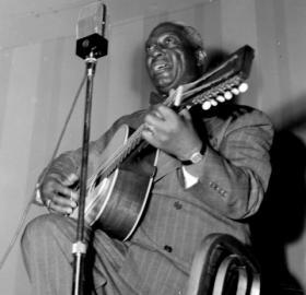 Portrait of Lead Belly, National Press Club, Washington, D.C., between 1938 and 1948 (Photo: William P. Gottlieb, Library of Congress)